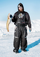 Hunter Weidenborner with Bemidji State University collects data on eel pout fish during the 39th Annual International Eel Pout Festival, at Leech Lake in Walker, Minnesota, February 23, 2018. Crowds that are more than 10 times the population of tiny Walker, Minn. (pop. 1,069) gather on Minnesota&rsquo;s third largest lake (112,000-acres), Leech Lake, for a festival named for one of the ugliest bottom-dwelling fish, the eelpout.<br /> <br /> Photo by Matt Nager