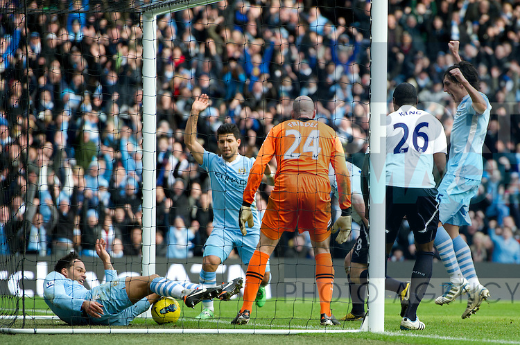Joleen Lescott of Manchester City bundles the ball over the line for the second goal.Barclays Premier League.Manchester City v Tottenham at the Eithad Stadium, Manchester 22nd January, 2012..Sportimage +44 7980659747.picturedesk@sportimage.co.uk.http://www.sportimage.co.uk/.Editorial use only. Maximum 45 images during a match. No video emulation or promotion as 'live'. No use in games, competitions, merchandise, betting or single club/player services. No use with unofficial audio, video, data, fixtures or club/league logos.