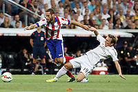Modric of Real Madrid and Mario Suarez of Atletico de Madrid during La Liga match between Real Madrid and Atletico de Madrid at Santiago Bernabeu stadium in Madrid, Spain. September 13, 2014. (ALTERPHOTOS/Caro Marin)