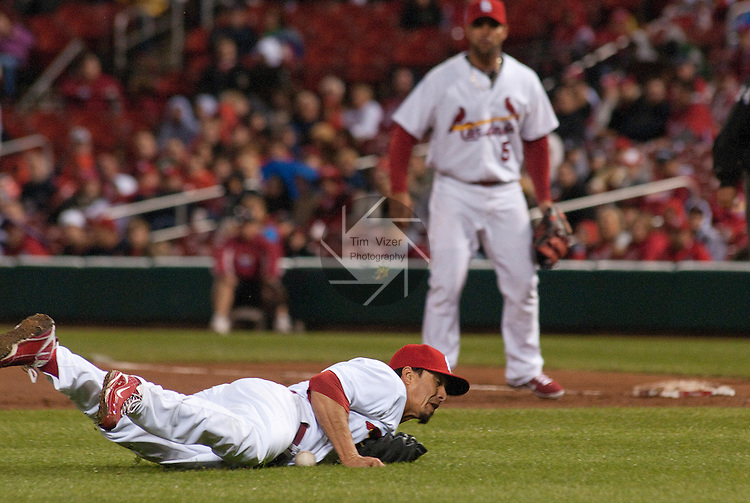 02 May 2011                                       St. Louis Cardinals starting pitcher Kyle Lohse (26) dives to stop a grounder hit up the middle by Florida Marlins starting pitcher Chris Volstad in the top of the fourth.  Lohse recovered, grabbed the ball and threw Volstad out at first base. The Florida Marlins defeated the St. Louis Cardinals 6-5 on Monday May 2, 2011 in the first game of a four-game series at Busch Stadium in downtown St. Louis.