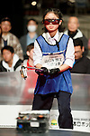 An international robot operator competes to win the International Robot Sumo Tournament 2016 at the Ryougoku Sumo Hall (Ryogoku Kokugikan) on December 18, 2016, Tokyo, Japan. The annual tournament invites the top-ranked winners of 16 national competitions to compete in Japan. It is organized by the All Japan Robot-Sumo Tournament which has been held since 1989. According to the rules the robot wrestler loses when their robot is forced out of the sumo ring. (Photo by Rodrigo Reyes Marin/AFLO)