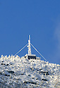 The summit of Cannon Mtn. sports a rime encrusted observation platform most of the winter, captured here contrasting with a clear blue sky.