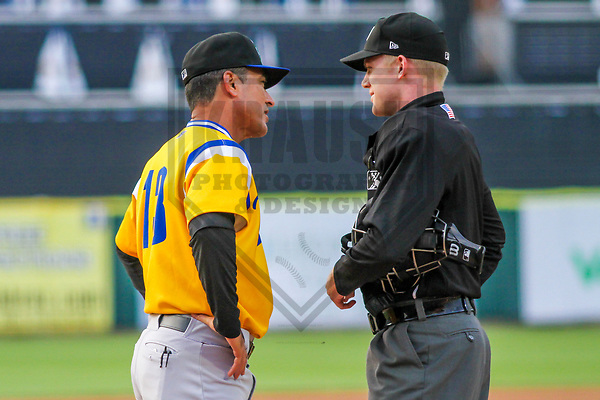 Biloxi Shuckers manager Mike Guerrero (13) and home plate umpire Matt Winter during a Southern League game against the Tennessee Smokies on May 25, 2017 at Smokies Stadium in Kodak, Tennessee.  Tennessee defeated Biloxi 10-4. (Brad Krause/Krause Sports Photography)