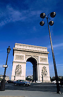 Traffic driving around the Arc de Triomphe roundabout, Paris, France.