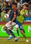 Seattle Sounders Brad Evans (3) defends New England Revolution  Juan Agudelo (17) during an MLS match on March 8, 2015 in Seattle, Washington.  The Sounders beat the Revolution 3-0.  Jim Bryant Photo. ©2015. All Rights Reserved.