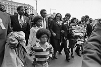 Coretta Scott King, wearing glasses, leads a march through downtown Atlanta Sunday, March 15, 1981 accompanied by entertainer Ben Vereen, upper left. The March was organized in memory of the 22 missing and murdered children of Atlanta. (AP Photo/Gary Gardiner)