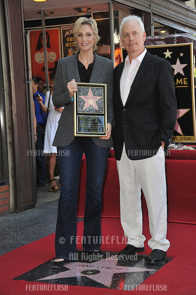 Glee star Jane Lynch &amp; Christopher Guest on Hollywood Blvd where she was honored with the 2,505th star on the Hollywood Walk of Fame.<br /> September 4, 2013  Los Angeles, CA<br /> Picture: Paul Smith / Featureflash