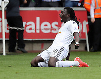 SWANSEA, WALES - MAY 17: Bafetimbi Gomis of Swansea celebrates his goal which made the score 2-2 during the Premier League match between Swansea City and Manchester City at The Liberty Stadium on May 17, 2015 in Swansea, Wales. (photo by Athena Pictures/Getty Images)
