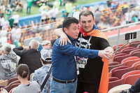 MOSCOW, RUSSIA - June 17, 2018:  Two fans pose for a photo before their 2018 FIFA World Cup group stage match at Luzhniki Stadium.