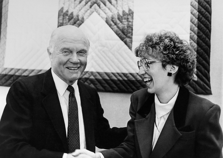 Sen. John Herschel Glenn, D-Ohio, Senate Committee on Governmental Affairs Chairman greeting a woman. March 1988 (Photo by CQ Roll Call)