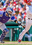 14 April 2018: Colorado Rockies catcher Tony Wolters apples a tag on Moises Sierra during a game against the Washington Nationals at Nationals Park in Washington, DC. The Nationals rallied to defeat the Rockies 6-2 in the 3rd game of their 4-game series. Mandatory Credit: Ed Wolfstein Photo *** RAW (NEF) Image File Available ***
