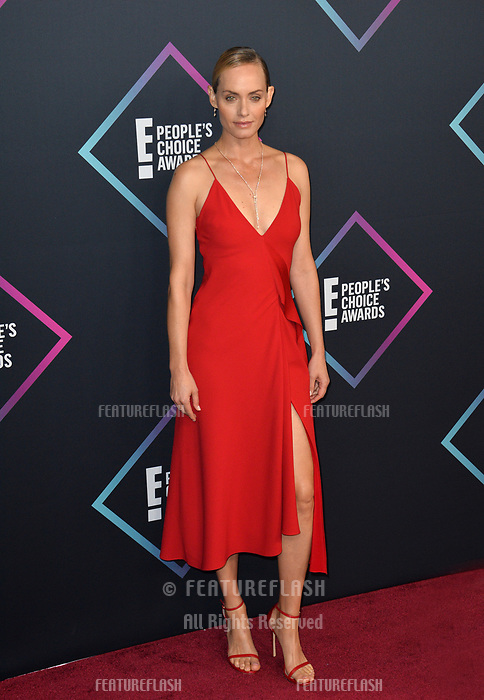 LOS ANGELES, CA. November 11, 2018: Amber Valletta at the E! People's Choice Awards 2018 at Barker Hangar, Santa Monica Airport.<br /> Picture: Paul Smith/Featureflash