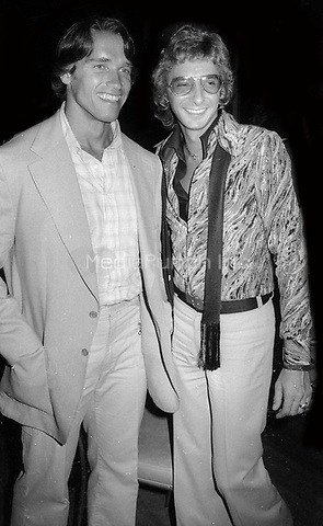 Arnold Schwarzenegger and Barry Manilow1978<br /> Photo By Adam Scull/PHOTOlink/MediaPunch