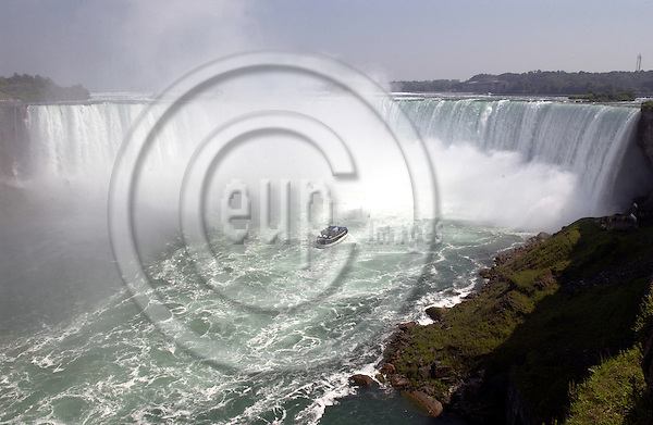 Niagara Falls, Ontario, Canada - 01 August 2006---The 'Maid of the Mist', a boat with tourists / visitors cruising on the Niagara River into the Horseshoe Falls---transport, tourism, landscape, nature---Photo: Horst Wagner / eup-images