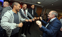 Pictured L-R: Players Wayne Routledge, Ashley Williams and Kyle Bartley are entertained by a magician <br />