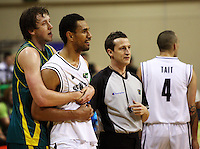 Boomers forward Joe Ingles restrains Mika Vukona after tempers flare during the International basketball match between the NZ Tall Blacks and Australian Boomers at TSB Bank Arena, Wellington, New Zealand on 25 August 2009. Photo: Dave Lintott / lintottphoto.co.nz