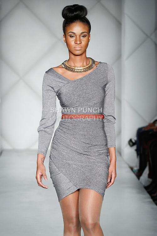 Model walks runway in an outfit from the Ikhonic Fall 2014 collection by Nicole Anne Khoury, during Fashion Week Brooklyn Fall Winter 2014, day two at Industry City, on March 16, 2014.