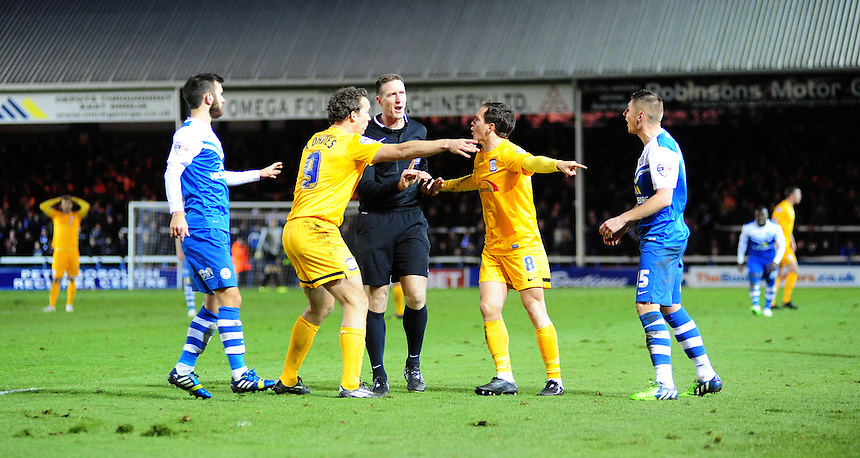 Preston North End's Kevin Davies, left, and Preston North End's Neil Kilkenny speak to Referee Darren Sheldrake after he gave a free kick for Peterborough United after a challenge from Preston North End&rsquo;s Jermaine Beckford on Peterborough United's Michael Bostwick<br /> <br /> Photographer Chris Vaughan/CameraSport<br /> <br /> Football - The Football League Sky Bet League One - Peterborough United v Preston North End - Saturday 20th December 2014 - ABAX Stadium - Peterborough<br /> <br /> &copy; CameraSport - 43 Linden Ave. Countesthorpe. Leicester. England. LE8 5PG - Tel: +44 (0) 116 277 4147 - admin@camerasport.com - www.camerasport.com