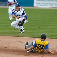 26 july 2010: Maxime Lefevre of France jumps over Maksym Symchyna of Ukraine as he throws the ball to first base for a double play during France 10-2 victory over Ukraine, in day 4 of the 2010 European Championship Seniors, in Neuenburg, Germany.
