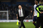Home manager Sean Dyche taking off his jacket as he walks across the pitch at half-time as Burnley hosted Everton in an English Premier League fixture at Turf Moor. Founded in 1882, Burnley played their first match at the ground on 17 February 1883 and it has been their home ever since. The visitors won the match 5-1, watched by a crowd of 21,484.