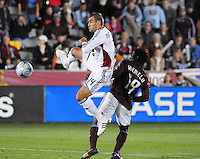 25 October 08: Real Salt Lake forward Yura Movsisyan (14) moves the ball past Rapids defender Ugo Ihemelu. Real Salt Lake tied the Colorado Rapids 1-1 at Dick's Sporting Goods Park in Commerce City, Colorado. The tie advanced Real Salt Lake to the playoffs.