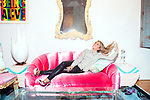 "Interior designer Sasha Bikoff at her new store in Tribeca on a vintage deco ""croissant"" sofa upholstered in pink velvet. <br /> <br /> <br /> Danny Ghitis for The New York Times"