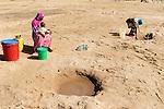 TANZANIA, Kondoa, people fetch drinking water from dry river bed  / TANSANIA, Kondoa, Menschen schoepfen Wasser aus einem trockenen Flussbett