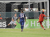 D.C. United forward Dwayne De Rosario scores on a penalty kick in the 33th minute of the game.  D.C. United tied Paris St. Germain 1-1 at RFK Stadium, Saturday 28, 2012.