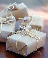 Gifts wrapped in brown paper personalised with shells