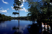 Church members are baptised in the Suwannee River. <br /> It is a wild blackwater river, about 266 miles long flowing from the Okefenokee Swamp to the Gulf of Mexico.