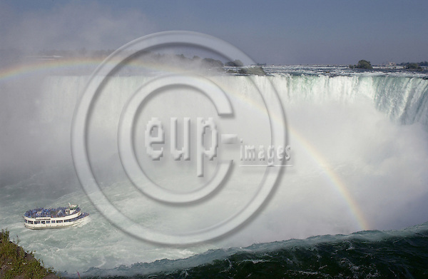 Niagara Falls, Ontario, Canada - 01 August 2006---The Niagara River falling horseshoe-wise / Horseshoe Falls with rainbow, the boat 'Maid of the Mist' cruises into the fall---nature, transport, tourism---Photo: Horst Wagner / eup-images