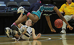 Southside High School's Katisha Hyman trips over Bishop McGuinness' Sammi Goldsmith while chasing a loose ball during the Villains' 60-44 win, a 7th-consecutive state title and a new state record, at the Dean Smith Center in Chapel Hill, NC, on Saturday, March 10, 2012.  Photo by Ted Richardson
