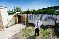Pictured: The top of the car wash as seen from the back garden of the house owned by Anne Parker in Pontypridd, Wales, UK. Monday 02 July 2018<br /> Re: Pensioner Anne Parker says the peace and quiet of her garden has been shattered after a car wash was installed by rental firm Enterprise on the other side of her back fence in Pontypridd, Wales, UK.