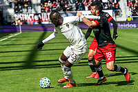 WASHINGTON, DC - FEBRUARY 29: Felipe Martins #18 of DC United holds onto Kei Kamara #23 of the Colorado Rapids during a game between Colorado Rapids and D.C. United at Audi Field on February 29, 2020 in Washington, DC.