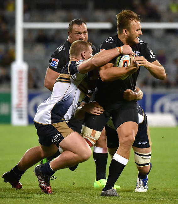 Sharks player Andre Esterhuizen is tackled by Brumbies players during the Super Rugby match between the ACT Brumbies and the South African Sharks in Canberra on March 4, 2017. AFP PHOTO / MARK GRAHAM --- IMAGE RESTRICTED TO EDITORIAL USE - STRICTLY NO COMMERCIAL USE --