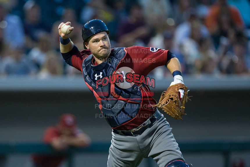 Lehigh Valley Iron Pigs catcher Andrew Knapp (15) makes a throw to first base against the Charlotte Knights at BB&T BallPark on June 3, 2016 in Charlotte, North Carolina.  The Iron Pigs defeated the Knights 6-4.  (Brian Westerholt/Four Seam Images)