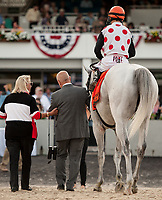 TAMPA, FL - February 10: World Approval, #7, returns to the winner's circle with Live Oak Stud Owner Charlotte Weber after his win under John Velazquez in the Tampa Bay Stakes (Grade II) for trainer Mark Casse at Tampa Bay Downs on February 10, 2018 in Tampa, FL. (Photo by Carson Dennis/Eclipse Sportswire/Getty Images.)