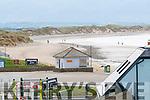 People walking on Ballyheihue beach on Sunday.