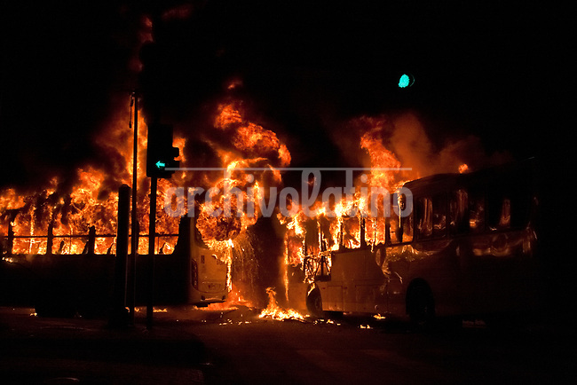 Demonstrators clash with police and set on fire a couple of buses in dowtown Rio de Janeiro during the national strike against labor and retirement reforms led by President Michel Temer in Brazil