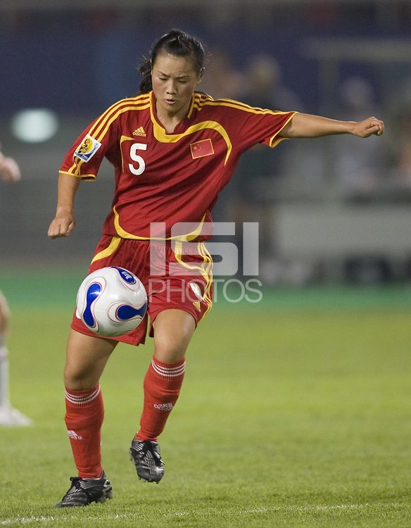 China midfielder (5) Xong Xiaoli. The Peoples Republic of China (CHN) defeated Denmark (DEN) 3-2 during their FIFA Women's World Cup China 2007 opening round Group D match at Wuhan Sports Center Stadium in Wuhan, China on September 12, 2007.
