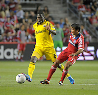 Columbus midfielder Tony Tchani (6) reaches the ball before Chicago midfielder Pavel Pardo (17).  The Chicago Fire defeated the Columbus Crew 2-1 at Toyota Park in Bridgeview, IL on June 23, 2012.