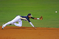 2 March 2012:  FIU shortstop Julius Gaines (2) dives after a ground ball early in the game as the FIU Golden Panthers defeated the Brown University Bears, 6-5, at University Park Stadium in Miami, Florida.