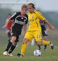 U.S. Open Cup Round of 16: Columbus Crew's Sebastian Rozental (22) controls the ball and is defended by DC United's Brian Carroll (16). DC United defeated the Columbus Crew in overtime 2-1. Tuesday, August 1, 2006, at Maryland Soccerplex.