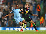 Raheem Sterling of Manchester City tussles with Ibrahima Traore of Borussia Monchengladbach during the UEFA Champions League Group C match at The Etihad Stadium, Manchester. Picture date: September 14th, 2016. Pic Simon Bellis/Sportimage