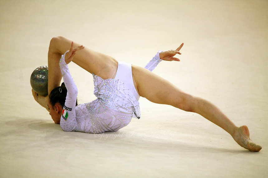 Romina Laurito of Italy shows flexibility with ball on carpet beginning routine during senior All-Around at 2006 Trofeo Cariprato in Prato, Italy on June 17, 2006.  Romina placed 4th in this international tournament.  (Photo by Tom Theobald)