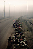 Southern Kuwait<br /> March 3, 1991<br /> <br /> American military forces move north towards Kuwait City shrouded in smoke after the Iraqi military fled north to Iraq setting fires off at oil facilities throughout Kuwait.
