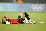 19 August 2008: Logna Bailly (BEL) lies on the turf after the Belgium loss.  The men's Olympic soccer team of Nigeria defeated the men's Olympic soccer team of Belgium 4-1 at Shanghai Stadium in Shanghai, China in a Semifinal match in the Men's Olympic Football competition.