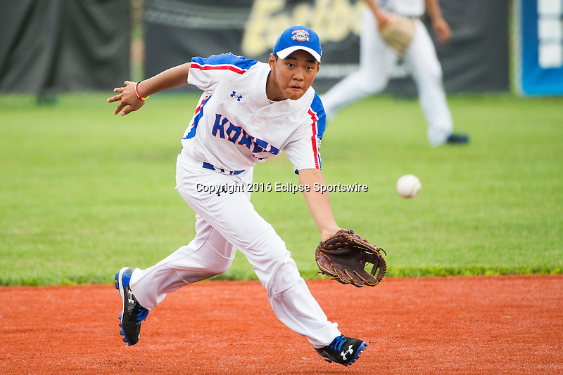 ABERDEEN, MD - AUGUST 01: Junsun Yoon #17 of the Republic of Korea attempts to field a ground ball hit by Australia in a game between the Republic of Korea and Australia during the Cal Ripken World Series at The Ripken Experience Powered by Under Armour on August 1, 2016 in Aberdeen, Maryland. (Photo by Ripken Baseball/Eclipse Sportswire/Getty Images)