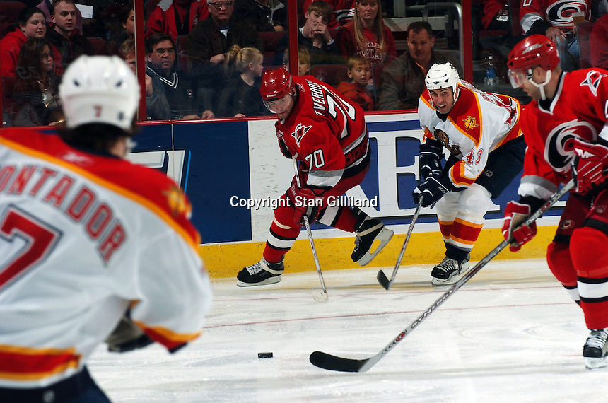 Carolina Hurricanes' defenseman Oleg Teverdovsky (70) of Russia passes across the ice defended by the Florida Panthers' Mikhail Yakubov (42) during their game at the RBC Center in Raleigh, NC Friday, March 3, 2006. Carolina won 5-2.
