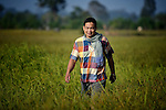 Ken Cruz walks through a rice field in the Cambodian village of Somrith. A United Methodist missionary from the Philippines, Cruz works with the Community Health and Agricultural Development program of the Methodist Mission in Cambodia.